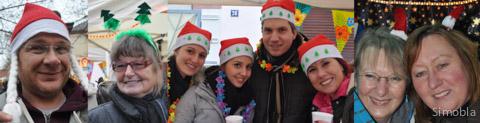 Variationen von weihnachtlichen Kopfbedeckungen tragen (von links) Mathias Schlossarek und Meike Bartelt vom Kinder- und Jugendhaus, das Team vom Kindergarten St. Kilian sowie Heidi Derstroff und Christa Hauff vom Karnevalverein.